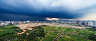 Aerial view of a storm approaching farmlands and wastelands between Lac Long Quan and Tu Liem District, Hanoi, Vietnam, Southeast Asia