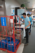 Staff dealing with online orders<br /><br />Hema mega supermarket stores offer a mixture of online and immediate purchase. online goods can arrive fresh within 30 minutes of ordering. Staff literally run around the stores armed with digital decoders collecting customers online orders for fast delivery.