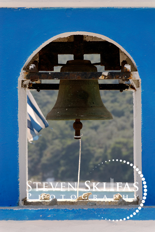 Samos. Greece. View of the Bell and tower of typically picturesque blue and white washed Greek Orthodox Church at the pretty Northern seaside town of Avlakia. Samos is Greece's eight largest island and it belongs to the North-eastern Aegean group of Greek islands. Situated only 1200 metres from the shores of Turkey and Asia minor Samos is blessed with stunning lush, green and mountainous landscapes. Samos is also historically rich and has UNESCO World Heritage listed sites and it is also the birthplace the famous mathematician and philosopher Pythagoras and the great ancient astronomer Aristarchus.
