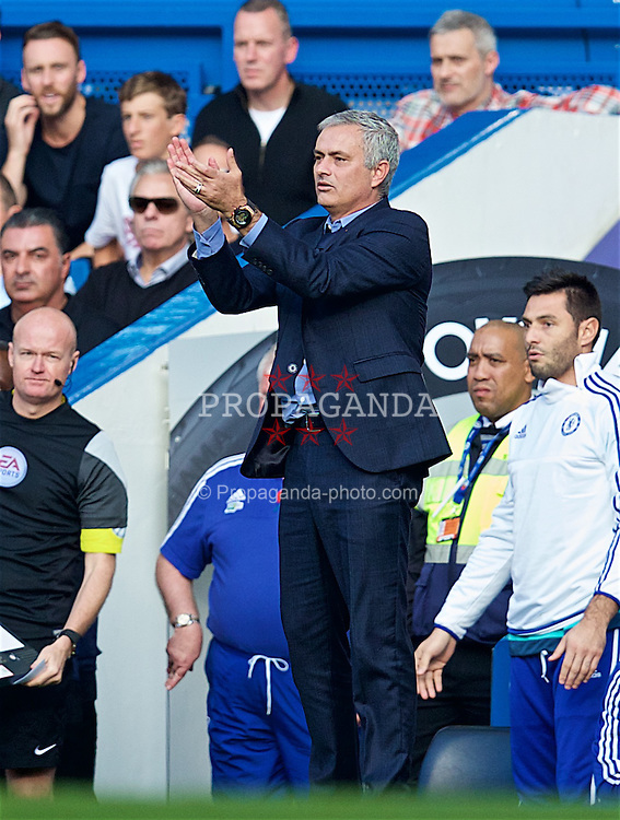 LONDON, ENGLAND - Saturday, October 31, 2015: Chelsea's manager Jose Mourinho reacts with applause as Liverpool's Lucas Leiva is spared a yellow card during the Premier League match at Stamford Bridge. (Pic by David Rawcliffe/Propaganda)