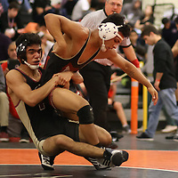 Miguel Reyes of Cupertino and Eli Clark of Fremont in the 2018 SCVAL Wrestling Finals (132 lb)(Photo by Bill Gerth)