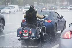 Riding in a downpour during Daytona Beach Bike Week. FL. USA. Sunday March 12, 2017. Photography ©2017 Michael Lichter.