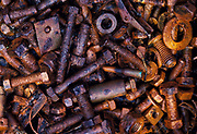 Rust on bolts, orange and brown colour, mechanical, metal oxide, oxidisation, chemical reaction