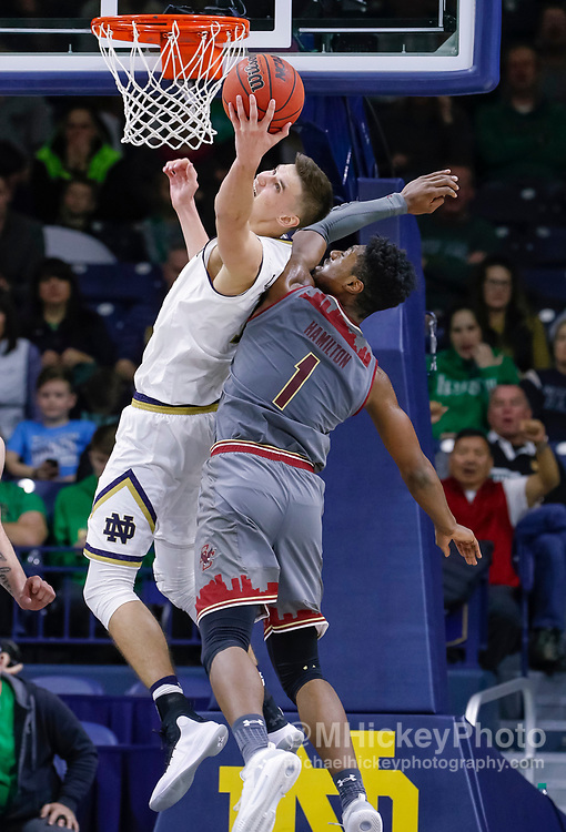 SOUTH BEND, IN - JANUARY 12: Nate Laszewski #14 of the Notre Dame Fighting Irish reaches back for the rebound against Jairus Hamilton #1 of the Boston College Eagles at Purcell Pavilion on January 12, 2019 in South Bend, Indiana. (Photo by Michael Hickey/Getty Images) *** Local Caption *** Nate Laszewski; Jairus Hamilton