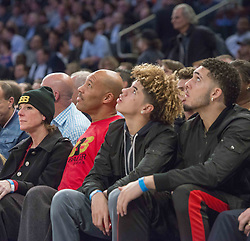 December 12, 2017 - Manhattan, NY, USA - From left, Tina Ball, LaVar Ball, LaMelo Ball and LiAngelo Ball look on as the New York Knicks welcome the Los Angeles Lakers to Madison Square Garden in New York on Tuesday, Dec. 12, 2017. (Credit Image: © Howard Simmons/TNS via ZUMA Wire)
