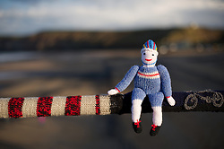© Licensed to London News Pictures. 07/03/2012..Saltburn, England..A number of knitted figures have mysteriously appeared on the Victorian pier at Saltburn in Cleveland depicting various scenes from the Olympics. The Yarnbomber, as the person or persons have become know locally, have knitted a 50 foot long scarf incorporating the figures and attached it to the railing along the pier..So far the identity of the yarn bomber is unknown...Photo credit : Ian Forsyth/LNP