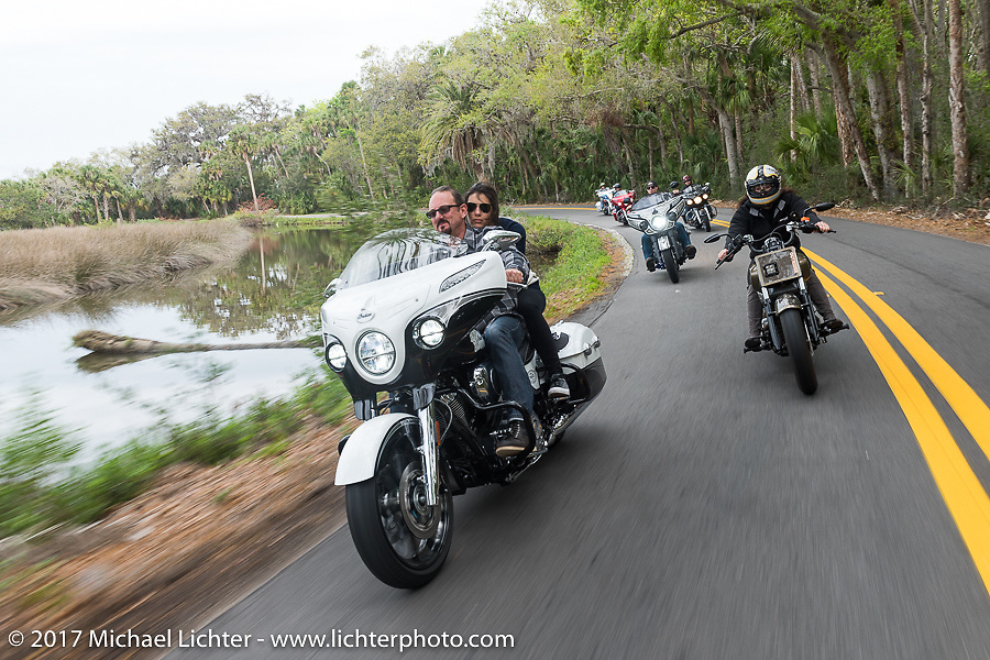 Klock Werks' Brian Klock and Venessa Nay riding one of the limited edition Jack Daniel's Indian Chieftain motorcycles (L) that Brian designed alongside Karlee Kobb on her custom Indian Scout through Tamoka State Park during Daytona Beach Bike Week. FL. USA. Monday March 13, 2017. Photography ©2017 Michael Lichter.