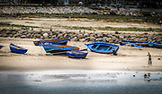 Blue beached fishing boats. Morocco