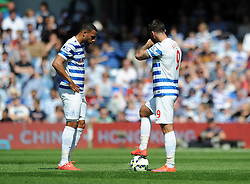 Queens Park Rangers' Charlie Austin and Queens Park Rangers' Matt Phillips cut dejected figures after conceding a goal   - Photo mandatory by-line: Dougie Allward/JMP - Mobile: 07966 386802 - 16/05/2015 - SPORT - football - London - Loftus Road - QPR v Newcastle United - Barclays Premier League