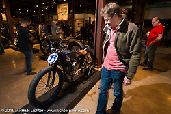 Checking out Brittney Olsen's Harley-Davidson racer at the Friday night opening of the Handbuilt Motorcycle Show. Austin, TX. April 10, 2015.  Photography ©2015 Michael Lichter.