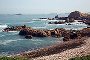 Rocky coastline  Albecq headland Guernsey Channel Islands west coast