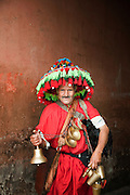 A water seller in traditional dress at the Djemaa el Fna in the medina of Marrakech, Morocco