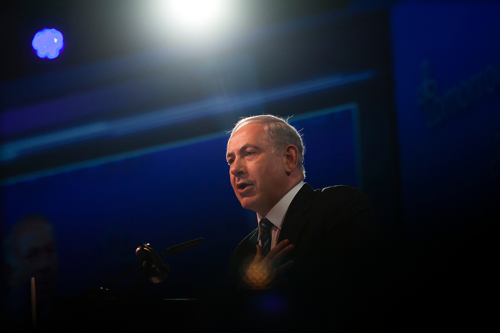 Israel's Prime Minister Benjamin Netanyahu gestures as he speaks during the closing plenary session of the 5th annual Israeli Presidential Conference, titled 'The Decisions that will Shape Tomorrow' in Jerusalem, Israel, on June 20, 2013.