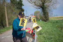 A local man distributes Flemish flags during the Ronde Van Vlaanderen - a 153.2 km road race, starting and finishing in Oudenaarde on April 2, 2017, in East Flanders, Belgium.