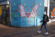 Wings of love graffiti in the City Centre on the day it was announced that Birmingham would be placed in tier three for very high alert level of the new Coronavirus tier system following the end of the second national lockdown on 26th November 2020 in Birmingham, United Kingdom. The national lockdown and following tier 3 status is a huge blow to the economy and for individual businesses in Britain's second city, who were already struggling after eight months of Covid-19 restrictions. In tier 3 people can only meet other households in outdoor public spaces like parks, where the rule of six applies.