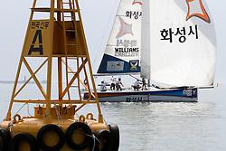 Ian Williams sails past a channel marker. Korea Match Cup 2010. World Match Racing Tour. Gyeonggi, Korea. 11 June 2010. Photo: Gareth Cooke/Subzero Images