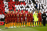 Motherwell pay their respects on Remembrance Sunday ahead of the Ladbrokes Scottish Premiership match between Rangers and Motherwell at Ibrox, Glasgow, Scotland on Sunday 11th November 2018.