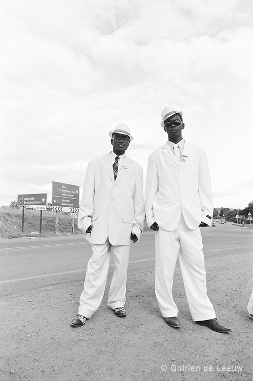Men in rented suits are on their way to attend a funeral. Eastern Cape province, South Africa