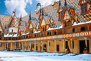Hospice De Beaune in the snow .<br /> <br /> Visit our FRANCE HISTORIC PLACES PHOTO COLLECTIONS for more photos to download or buy as wall art prints https://funkystock.photoshelter.com/gallery-collection/Pictures-Images-of-France-Photos-of-French-Historic-Landmark-Sites/C0000pDRcOaIqj8E