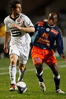 FOOTBALL - FRENCH CHAMPIONSHIP 2009/2010 - L1 - MONTPELLIER HSC v STADE RENNAIS - 27/02/2010 - PHOTO PHILIPPE LAURENSON / DPPI - CARLOS BOCANEGRA (REN) / SOULEYMANE CAMARA (MON)