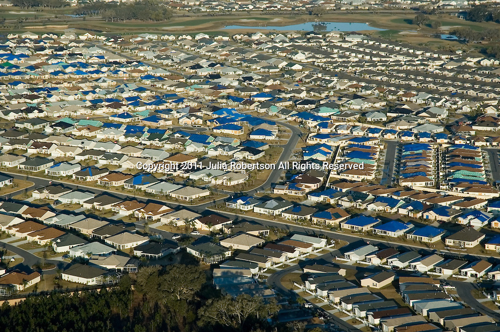 Aerial photographs of the Villages, Florida, blue tarps of hurricane damaged roof tops