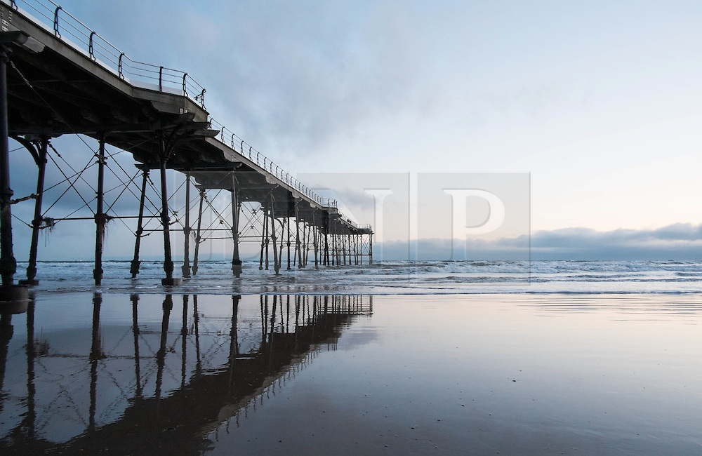 © Licensed to London News Pictures. 10/03/2014<br /> <br /> Saltburn, Cleveland, United Kingdom<br /> <br /> The Victorian Pier is reflected in wet sand at first light in Saltburn by the Sea in Cleveland.<br /> <br /> Photo credit : Ian Forsyth/LNP