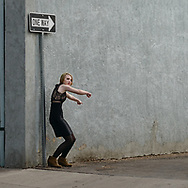 Woman gesturing in alley, Loveland CO