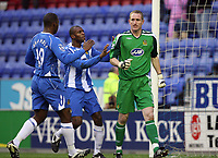 Photo: Paul Greenwood/Sportsbeat Images.<br />Wigan Athletic v Blackburn Rovers. The FA Barclays Premiership. 15/12/2007.<br />Wigan's keeper Chris Kirkland (R) is congartulated by team mates Emerson Boyce and Titus Bramble after he saves Benni McCarthy's penalty