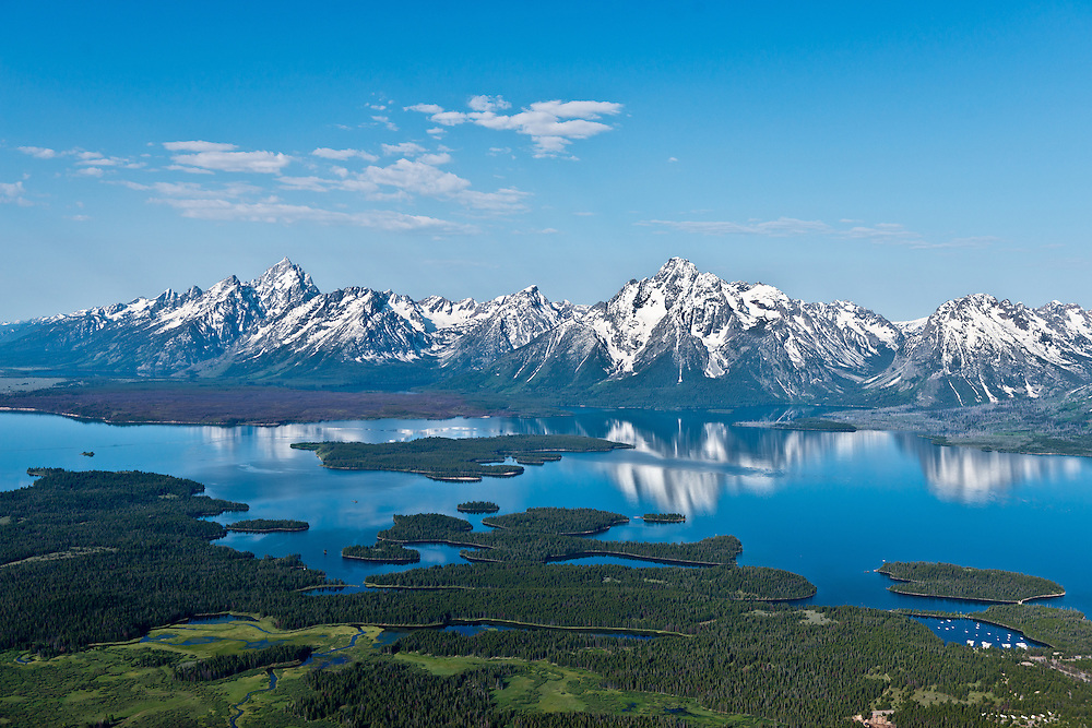 Aerial view of Jackson Lake and the Teton Mountain Range in Teton National Forest on beautiful calm spring morning. Licensing and Open Edition Prints