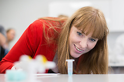 © Licensed to London News Pictures . 26/09/2016 . Liverpool , UK . Shadow Education Minister ANGELA RAYNOR is shown how to take a DNA swab , along with students studying biology , in a new science lab at Liverpool City College , at a visit during the second day of the Labour Party Conference in Liverpool . Photo credit : Joel Goodman/LNP