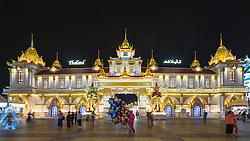 Illuminated Thailand Pavilion at night at Global Village 2015 in Dubai United Arab Emirates