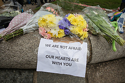 © Licensed to London News Pictures. 23/03/2017. London, UK. Flowers are left for the victims of the Westminster Attack by a police cordon close to Parliament Square. Photo credit: Rob Pinney/LNP