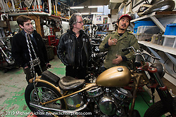 Go Takamine (red hat) with Harley-Davidson's design team members (L>R) Charlie Wartgow and team leader Ray Drea during their visit to Go's Brat Style shop. Tokyo, Japan. Monday, December 8, 2014. Photograph ©2014 Michael Lichter.