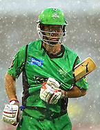 PERTH, AUSTRALIA - DECEMBER 12:  Rob Quiney of the Stars heads from the field as heavy rain sets in during the Big Bash League match between the Perth Scorchers and the Melbourne Stars at WACA on December 12, 2012 in Perth, Australia.  (Photo by Paul Kane/Getty Images)