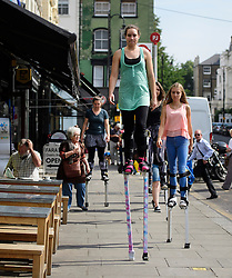 © Licensed to London News Pictures. 25/08/2016. London, UK. Members of the carnival group 'Youth With A Mission' practice using stilts around the streets of Notting Hill ahead of the annual Notting Hill Carnival which starts this bank holiday weekend. Photo credit: Ben Cawthra/LNP