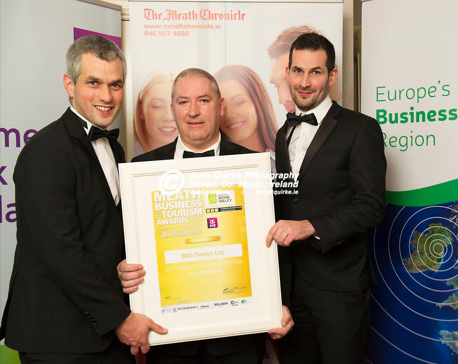 24-11-17. Meath Business and Tourism Awards 2017 at the Newgrange Hotel, Navan.<br /> Best Small to Medium Enterprise Award - BSG Design.<br /> Noel Moran (Centre), eCOMM Merchant Solutions (Sponsor) presenting the Best Small to Medium Enterprise Award to Barry (Left) and Stephen Goulding,<br />  BSG Design. <br /> Photo: John Quirke / www.quirke.ie<br /> ©John Quirke Photography, Unit 17, Blackcastle Shopping Cte. Navan. Co. Meath. 046-9079044 / 087-2579454.