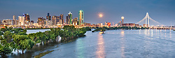 View of downtown and full moon during Trinity River flood, Dallas, Texas, USA.  Image licensed for non-exclusive usage in Stacy & Conder website. No other uses authorized. © Sean Fitzgerald. All Rights Reserved.