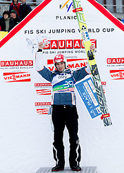 Winner Robert Kranjec of Slovenia celebrates at flower ceremony after the Flying Hill Individual competition at 2nd day of FIS Ski Jumping World Cup Finals Planica 2012, on March 16, 2012, Planica, Slovenia. (Photo by Vid Ponikvar / Sportida.com)