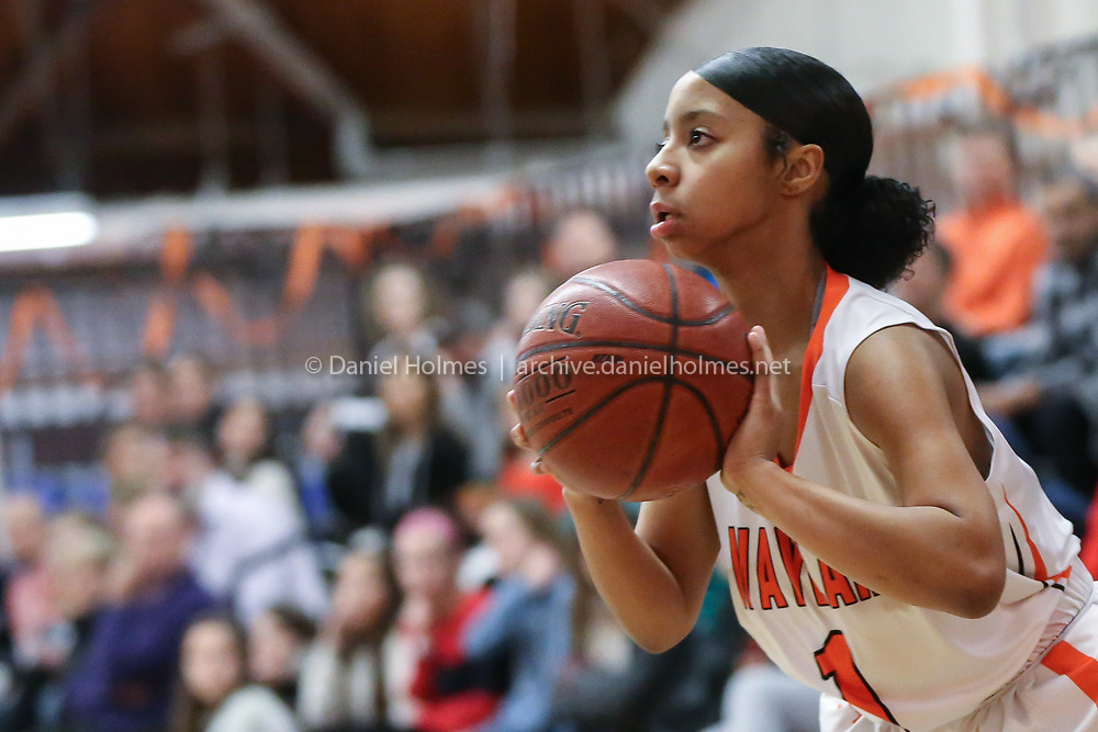 (2/14/20, WAYLAND, MA) Wayland's Saniyyah Phillips shoot a three-pointer during the girls basketball game against Weston at Wayland High School on Friday. [Daily News and Wicked Local Photo/Dan Holmes]