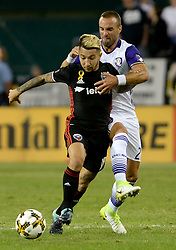 September 9, 2017 - Washington, DC, USA - 20170909 - D.C. United midfielder LUCIANO ACOSTA (10) battles to advance the ball against Orlando City FC defender SCOTT SUTTER (21) in the first half at RFK Stadium in Washington. (Credit Image: © Chuck Myers via ZUMA Wire)
