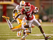Nov 12, 2011; Fayetteville, AR, USA; Arkansas Razorback wide receiver Jarius Wright (4) is tripped up by Tennessee Volunteers defensive back Brian Randolph (37) during the second half at Donald W. Reynolds Razorback Stadium. Mandatory Credit: Beth Hall-US PRESSWIRE