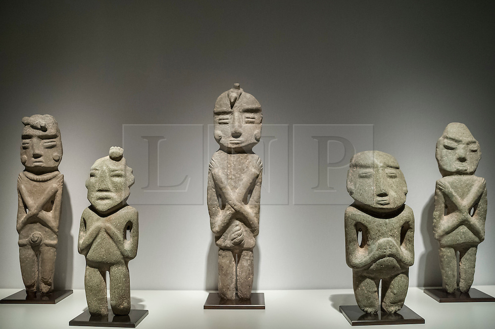 © Licensed to London News Pictures. 24/06/2015. London, UK.   A group of Mexican stylised shaman (350-100 B.C.) on display at the preview of Masterpiece London, the international cross-collecting Fair for art, antiques and design which takes place at The Royal Hospital Chelsea 25 June to 1 July. Photo credit : Stephen Chung/LNP