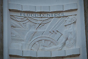 The bas-relief in Art Deco style celebrating benefits of the Hoover dam displayed on the elevator towers at the Hoover Dam, Nevada and Arizona. Hoover Dam, once known as Boulder Dam, is a concrete arch-gravity dam in the Black Canyon of the Colorado River, on the border between the U.S. states of Arizona and Nevada. When completed in 1936, it was both the world's largest hydroelectric power generating station and the world's largest concrete structure. It was surpassed in both these respects by the Grand Coulee Dam in 1945. It is currently the world's 38th-largest hydroelectric generating station