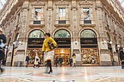 People walk through Galleria Vittorio Emmanuele II, the centre of luxury shopping in central Milan, on 9th December 2008 in Milan, Italy. The Galleria is known affectionately as the living room of Milan because of its popularity as a meeting place, and hosts the original Prada store.
