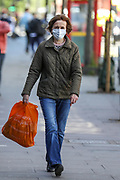 A woman wears a face mask during the coronavirus lockdown in South London, Tuesday, May 5, 2020. Whilst a few European countries relax the COVID-19 lockdown, Britain still remains under lockdown without an exit strategy yet. (Photo/Vudi Xhymshiti)
