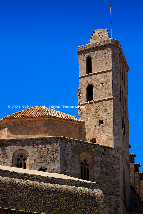 Ibiza Town Cathedral, against a clear blue sky, up on a hill overlooking the port, in the Balearic Islands.