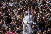 The final scene of a risen Jesus as he passes among the audience after being crucified on the cross during The Passion of Jesus which is performed in Londons Trafalgar Square by members of Wintershall Trust on London, 25th March 2016: Played annually on Good Friday it celebrates the cruxifixion and resurrection of Jesus Christ. The cast re-enacts the Christian Biblical story to an audience of thousands and the main character is played by professional actor James Burke-Dunsmore. .