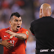 EAST RUTHERFORD, NEW JERSEY - JUNE 26:  Gary Medel #17 of Chile makes a point to Brazilian referee Heber Lopes during the Argentina Vs Chile Final match of the Copa America Centenario USA 2016 Tournament at MetLife Stadium on June 26, 2016 in East Rutherford, New Jersey. (Photo by Tim Clayton/Corbis via Getty Images)