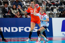 06-12-2019 JAP: Norway - Netherlands, Kumamoto<br /> Last match groep A at 24th IHF Women's Handball World Championship. / The Dutch handball players won in an exciting game of fear gegner Norway and wrote in the last group match at the World Handball  World Championship history (30-28). / Kelly Dulfer #18 of Netherlands, Stine Bredal Oftedal #10 of Norway