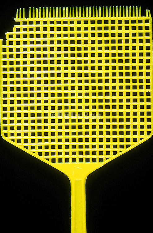 A yellow fly swatter